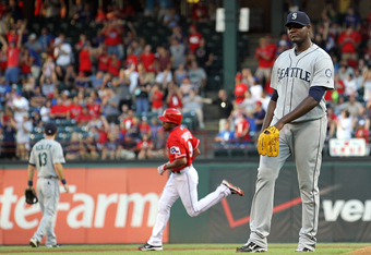 ARLINGTON, TX - AUGUST 09:  Michael Pineda #36 of the Seattle Mariners steps off the mound after giving up a home run against Endy Chavez #9 of the Texas Rangers  at Rangers Ballpark in Arlington on August 9, 2011 in Arlington, Texas.  (Photo by Ronald Ma