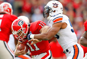 ATHENS, GA - NOVEMBER 12:  Aaron Murray #11 of the Georgia Bulldogs breaks away from a sack by Corey Lemonier #55 of the Auburn Tigers at Sanford Stadium on November 12, 2011 in Athens, Georgia.  (Photo by Kevin C. Cox/Getty Images)