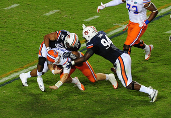 AUBURN, AL - OCTOBER 15: Jeff Driskel #16 of the Florida Gators is sacked by Corey Lemonier #55 and Nosa Eguae #94 of the Auburn Tigers at Jordan-Hare Stadium on October 15, 2011 in Auburn, Alabama. Photo by Scott Cunningham/Getty Images)