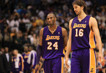 DALLAS, TX - MARCH 12:  Kobe Bryant #24 and Pau Gasol #16 of the Los Angeles Lakers react after a 96-91 win against the Dallas Mavericks at American Airlines Center on March 12, 2011 in Dallas, Texas.  NOTE TO USER: User expressly acknowledges and agrees