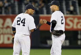 NEW YORK, NY - SEPTEMBER 20:  Robinson Cano #24 and Derek Jeter #2 of the New York Yankees celebrate after defeating the Tampa Bay Rays on September 20, 2011 at Yankee Stadium in the Bronx borough of New York City.  (Photo by Jim McIsaac/Getty Images)