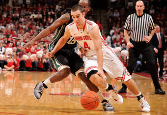 COLUMBUS, OH - DECEMBER 14:  Aaron Craft #4 of the Ohio State Buckeyes drives around Adrian Rodgers #15 of the South Carolina-Upstate Spartans in the first half on December 14, 2011 at Value City Arena in Columbus, Ohio.  (Photo by Jamie Sabau/Getty Image