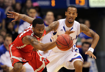 LAWRENCE, KS - DECEMBER 10:  William Buford #44 of the Ohio State Buckeyes loses the ball after it is knocked loose by Travis Releford #24 of the Kansas Jayhawks during the game on December 10, 2011 at Allen Fieldhouse in Lawrence, Kansas.  (Photo by Jami