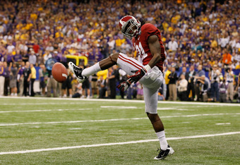 NEW ORLEANS, LA - JANUARY 09:  Dre Kirkpatrick #21 of the Alabama Crimson Tide reacts after a defensive stop in the third quarter against the Louisiana State University Tigers during the 2012 Allstate BCS National Championship Game at Mercedes-Benz Superd