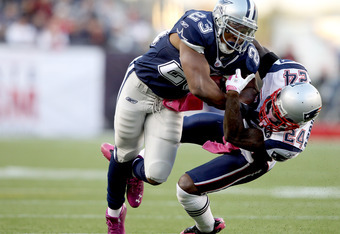 FOXBORO, MA - OCTOBER 16:  Tashard Choice #23 of the Dallas Cowboys is tackled by Kyle Arrington #24 of the New England Patriots on October 16, 2011 at Gillette Stadium in Foxboro, Massachusetts.  (Photo by Elsa/Getty Images)