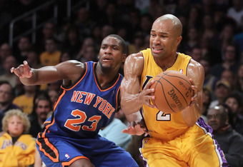 LOS ANGELES, CA - DECEMBER 29:  Derek Fisher #2 of the Los Angeles Lakers drives past Toney Douglas #23 of the New York Knicks at Staples Center on December 29, 2011 in Los Angeles, California. NOTE TO USER: User expressly acknowledges and agrees that, by