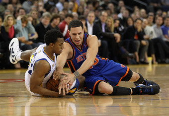 OAKLAND, CA - DECEMBER 28:  Ishmael Smith #12 of the Golden State Warriors and Mike Bibby #20 of the New York Knicks go for a loose ball at Oracle Arena on December 28, 2011 in Oakland, California.  NOTE TO USER: User expressly acknowledges and agrees tha
