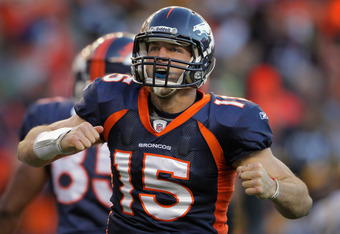 DENVER, CO - JANUARY 08:  Tim Tebow #15 of the Denver Broncos celebrates his second quarter rushing touchdown against the Pittsburgh Steelers at Sports Authority Field at Mile High on January 8, 2012 in Denver, Colorado. The Broncos defeated the Steelers