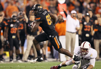 GLENDALE, AZ - JANUARY 02:  Justin Blackmon #81 of the Oklahoma State Cowboys runs for yards after the catch against Myles Muagututia #47 of the Stanford Cardinal during the Tostitos Fiesta Bowl on January 2, 2012 at University of Phoenix Stadium in Glend