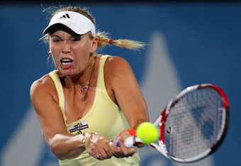 Caroline Wozniacki has lots of questions to answer. Her inflamed wrist doesn't help.