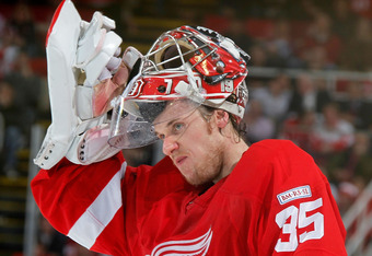 DETROIT, MI - JANUARY 12:  Jimmy Howard #35 of the Detroit Red Wings looks on while playing the Phoenix Coyotes at Joe Louis Arena on January 12, 2011 in Detroit, Michigan. Detroit won the game 3-2 in a shootout. (Photo by Gregory Shamus/Getty Images)