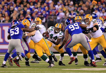 EAST RUTHERFORD, NJ - DECEMBER 04:  James Starks #44 of the Green Bay Packers runs the ball against the New York Giants at MetLife Stadium on December 4, 2011 in East Rutherford, New Jersey.  (Photo by Chris Trotman/Getty Images)