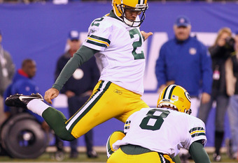 EAST RUTHERFORD, NJ - DECEMBER 04:  Mason Crosby #2 of the Green Bay Packers kicks a successful 30-yard game winning field goal in the fourth quarter against the New York Giants at MetLife Stadium on December 4, 2011 in East Rutherford, New Jersey.  (Phot