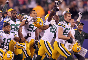 EAST RUTHERFORD, NJ - DECEMBER 04:  (L-R)  Randall Cobb #18, Greg Jennings #85, Vic So'oto #97, Donald Driver #80 and Jordy Nelson #87 of the Green Bay Packers celebrate after Mason Crosby #2 kicked a successful 30-yard game-winning field goal to beat the