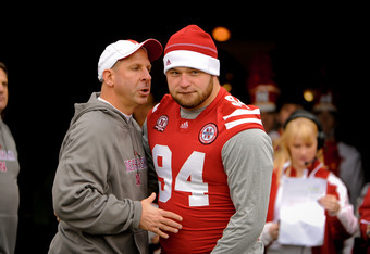 LINCOLN, NE - NOVEMBER 25: Defensive tackle Jared Crick #94 of the Nebraska Cornhuskers is greeted by Head Coach Bo Pelini on senior day before playing a  game against the Iowa Hawkeyes at Memorial Stadium November 25, 2011 in Lincoln, Nebraska. Nebraska