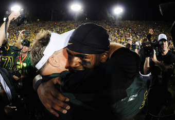 PASADENA, CA - JANUARY 02:  Head coach Chip Kelly of the Oregon Ducks hugs quarterback Darron Thomas #5 in celebration of the Ducks 45-38 victory over the Wisconsin Badgers at the 98th Rose Bowl Game on January 2, 2012 in Pasadena, California.  (Photo by