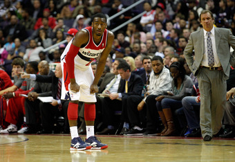 WASHINGTON, DC - JANUARY 06: Head coach Flip Saunders of the Washington Wizards (R) looks on as John Wall #2 gets set against the New York Knicks  at Verizon Center on January 6, 2012 in Washington, DC.  NOTE TO USER: User expressly acknowledges and agree