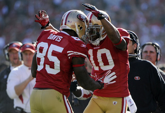 SAN FRANCISCO, CA - JANUARY 14:  Vernon Davis #85 and Kyle Williams #10 of the San Francisco 49ers celebrates after Davis goes forty nine yards on a pass play for a touchdown against the New Orleans Saints in the first quarter during the Divisional Playof