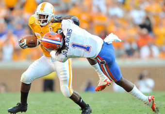 KNOXVILLE, TN - SEPTEMBER 18:  Janoris Jenkins #1 of the Florida Gators fights to bring down Tauren Poole #28 of the Tennessee Volunteers at Neyland Stadium on September 18, 2010 in Knoxville, Tennessee. Florida won 31-17.  (Photo by Grant Halverson/Getty