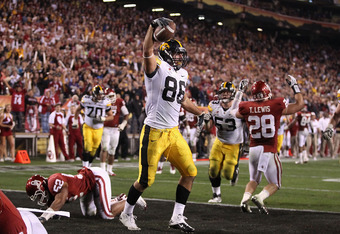 TEMPE, AZ - DECEMBER 30:  Tight end C.J. Fiedorowicz #86 of the Oklahoma Sooners celebrates after scoring on a 5 yard touchdown reception agianst the Iowa Hawkeyes during the fourth quarter of the Insight Bowl at Sun Devil Stadium on December 30, 2011 in