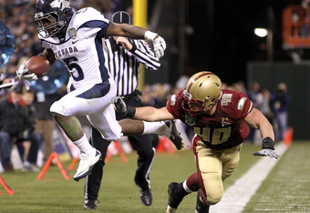 SAN FRANCISCO, CA - JANUARY 09:  Mike Ball #5 of the Nevada Wolf Pack is pushed out of bounds by Luke Kuechly #40 of Boston College during the Kraft Fight Hunger Bowl at AT&T Park on January 9, 2011 in San Francisco, California.  (Photo by Ezra Shaw/Getty