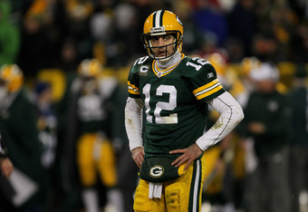 GREEN BAY, WI - JANUARY 15:  Aaron Rodgers #12 of the Green Bay Packers looks on in the third quarter against the New York Giants during their NFC Divisional playoff game at Lambeau Field on January 15, 2012 in Green Bay, Wisconsin.  (Photo by Jonathan Da