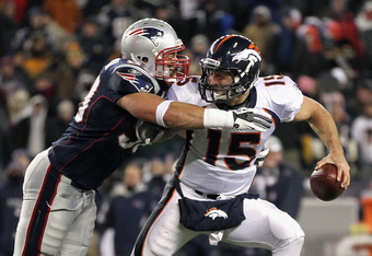 FOXBORO, MA - JANUARY 14:  Tim Tebow #15 (R) of the Denver Broncos is pressured by Rob Ninkovich #50 of the New England Patriots during their AFC Divisional Playoff Game at Gillette Stadium on January 14, 2012 in Foxboro, Massachusetts.  (Photo by Jim Rog