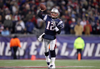 FOXBORO, MA - JANUARY 14:  Tom Brady #12 of the New England Patriots throws a pss against the Denver Broncos during their AFC Divisional Playoff Game at Gillette Stadium on January 14, 2012 in Foxboro, Massachusetts.  (Photo by Elsa/Getty Images)