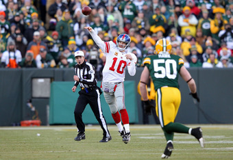 GREEN BAY, WI - JANUARY 15:  Eli Manning #10 of the New York Giants drops back to pass against the Green Bay Packers during their NFC Divisional playoff game at Lambeau Field on January 15, 2012 in Green Bay, Wisconsin.  (Photo by Jamie Squire/Getty Image
