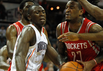 CHARLOTTE, NC - JANUARY 10:   Bismack Biyombo #0 of the Charlotte Bobcats tries to stop Jordan Hill #27 of the Houston Rockets on his way to the basket during their game at Time Warner Cable Arena on January 10, 2012 in Charlotte, North Carolina.   NOTE T