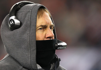 FOXBORO, MA - JANUARY 14:  Head coach Bill Belichick of the New England Patriots looks on against the Denver Broncos during their AFC Divisional Playoff Game at Gillette Stadium on January 14, 2012 in Foxboro, Massachusetts.  (Photo by Al Bello/Getty Imag