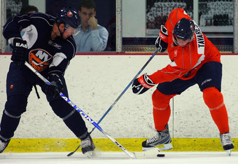 SYOSSET, NY - JULY 12:  John Tavares of the New York Islanders and Josh Bailey #12 battle for control of the puck during the prospect mini-camp open practice scrimmage on July 12, 2009 at Iceworks in Syosset, New York.  (Photo by Mike Stobe/Getty Images)