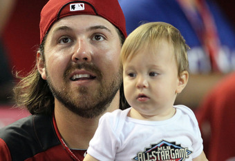 PHOENIX, AZ - JULY 11:  American League All-Star Chris Perez #54 of the Cleveland Indians looks on with his son Maxwell during the 2011 State Farm Home Run Derby at Chase Field on July 11, 2011 in Phoenix, Arizona.  (Photo by Jeff Gross/Getty Images)