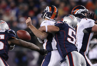 FOXBORO, MA - JANUARY 14:  Tim Tebow #15 of the Denver Broncos fumbles the ball in the first quarter as he is hit by Rob Ninkovich #50 of the New England Patriots during their AFC Divisional Playoff Game at Gillette Stadium on January 14, 2012 in Foxboro,