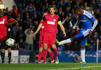 LONDON, ENGLAND - OCTOBER 19:  Salomon Kalou of Chelsea scores their fifth goal during the UEFA Champions League group E match between Chelsea and Genk at Stamford Bridge on October 19, 2011 in London, England.  (Photo by Paul Gilham/Getty Images)