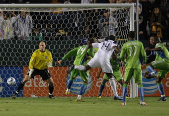 CARSON, CA - NOVEMBER 07:  Edson Buddle #14 of the Los Angeles Galaxy heads the ball in for a goal in the first half against goalkeeper Kasey Keller #18 of Seattle Sounders FC during the MLS Western Conference Semifinal match second leg at The Home Depot