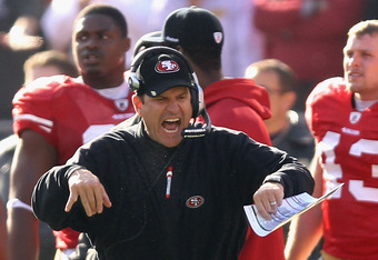 SAN FRANCISCO, CA - JANUARY 14:  Head coach Jim Harbaugh of the San Francisco 49ers reacts on the sidelines during the NFC Divisional playoff game against the New Orleans Saints at Candlestick Park on January 14, 2012 in San Francisco, California.  (Photo