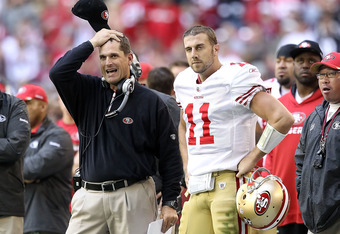GLENDALE, AZ - DECEMBER 11:  Head coach Jim Harbaugh of the San Francisco 49ers stands with quarterback Alex Smith #11 on the sidelines during the NFL game against the Arizona Cardinals at the University of Phoenix Stadium on December 11, 2011 in Glendale
