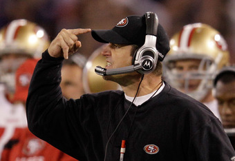 BALTIMORE, MD - NOVEMBER 24:  Head coach Jim Harbaugh of the San Francisco 49ers motions from the sidelines durnig the second half against the Baltimore Ravens at M&T Bank Stadium on November 24, 2011 in Baltimore, Maryland.  (Photo by Rob Carr/Getty Imag