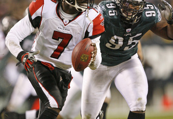 Michael Vick (7) scrambles out of the pocket as Eagles defensive end Jerome McDougle (95) pursues during the game between the Atlanta Falcons and the Philadelphia Eagles at Lincoln Financial Field in Philadelphia, Pennsylvania, December 31, 2006. (Photo b
