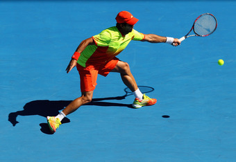 MELBOURNE, AUSTRALIA - JANUARY 16:  Fernando Verdasco of Spain plays a forehand during his round one match against Bernard Tomic of Australia during day one of the 2012 Australian Open at Melbourne Park on January 16, 2012 in Melbourne, Australia.  (Photo