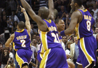 SAN ANTONIO - MAY 13:  Derek Fisher #2 leads Gary Payton #20 and Kobe Bryant #8 of the Los Angeles Lakers off the floor after Fisher made the game-winning shot with .4 seconds remaining beat the San Antonio Spurs in game five of the Western Conference Sem
