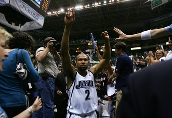 SALT LAKE CITY - MAY 15:  Derek Fisher #2 of the Utah Jazz celebrates a 100-87 win over the Golden State Warriors after the fourth quarter in Game Five of the Western Conference Semifinals during the 2007 NBA Playoffs at the EnergySolutions Arena on May 1