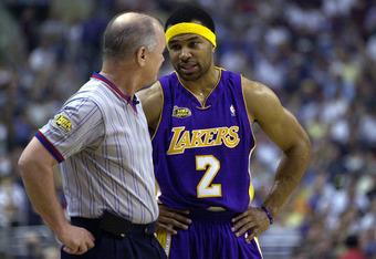 15 Jun 2001:  Derek Fisher #2 of the Los Angeles Lakers talks to a referee in game five of the NBA Finals against the Philadelphia 76ers at the First Union Center in Philadelphia, Pennsylvania.  The Lakers won 108-86 to take the series 4-1 and the NBA Cha