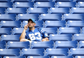 A passionate NFL fan sits with all of his friends.