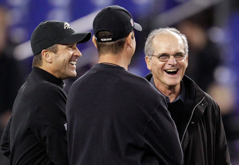 BALTIMORE, MD - NOVEMBER 24:  Head coach Jim Harbaugh (C) of the San Francisco 49ers and his brother, head coach John Harbaugh of the Baltimore Ravens (L) talk with their dad, Jack before the start of the game between the Baltimore Ravens and the San Fran