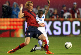 MIAMI GARDENS, FL - OCTOBER 08: Forward Brek Shea #11 of the USA defends against Roger Rojas #11 of Honduras at Sun Life Stadium on October 8, 2011 in Miami Gardens, Florida.  (Photo by Marc Serota/Getty Images)
