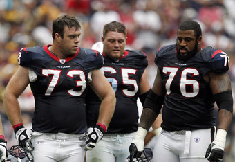 HOUSTON - OCTOBER 02:  Eric Winston #73, Mike Brisiel #65 and Duane Brown #76 of the Houston Texans stand over wide reciever Andre Johnson #80 as was helpled by the training staff after going down with an injury against the Pittsburgh Steelers at Reliant