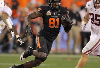GLENDALE, AZ - JANUARY 02:  Justin Blackmon #81 of the Oklahoma State Cowboys makes a reception against Jarek Lancaster #35 of the Stanford Cardinal during the Tostitos Fiesta Bowl on January 2, 2012 at University of Phoenix Stadium in Glendale, Arizona.