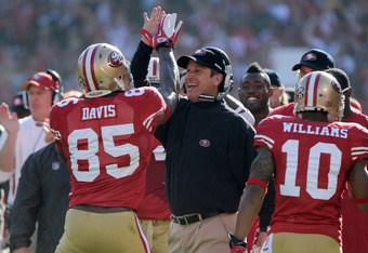 SAN FRANCISCO, CA - JANUARY 14:  Vernon Davis #85 of the San Francisco 49ers celebrates with head coach Jim Harbaugh after Davis scored a touchdown in the first quarter against the New Orleans Saints during the NFC Divisional playoff game at Candlestick P
